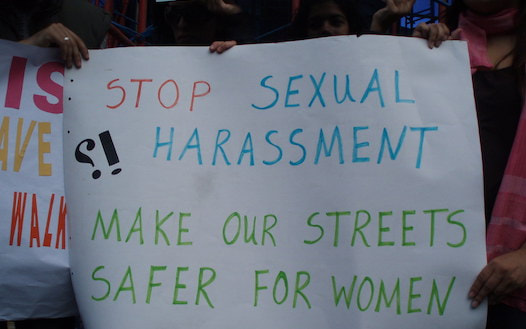 Photo showing a sign protesting sexual harassment